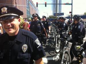 Smiling Police Officer at the March on Wall Street South Protest